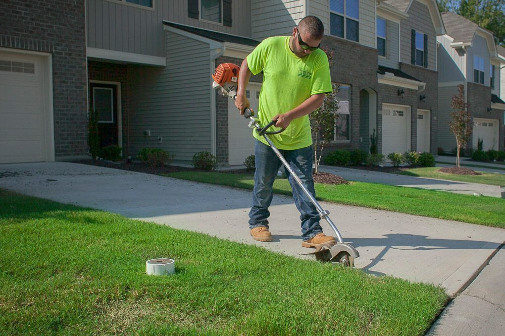 Pipeline Technician Edging Lawn - Lawn Care Services