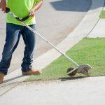 Pipeline Technician Edging Lawn